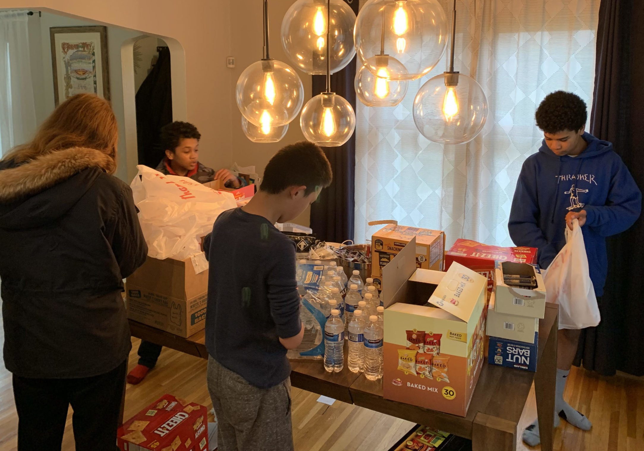 Church teens helping to assemble care packages for cops